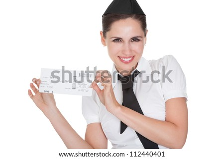 Smiling welcoming hospitality hostess presenting a voucher in her hands isolated on white - stock photo