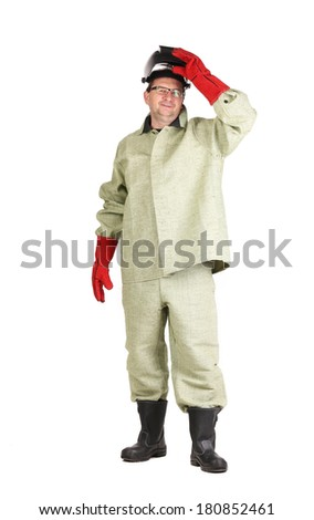 Smiling welder. Isolated on a white background. - stock photo