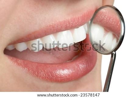 Smiling white teeth mouth with dental mirror - stock photo
