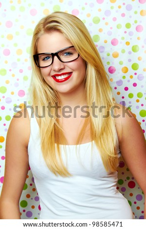smiling woman against dot background - stock photo