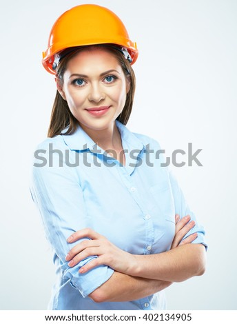 Smiling woman architect white background isolated portrait. Business woman wearing protect helmet. - stock photo