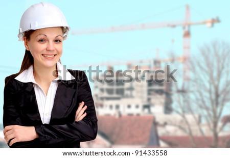 Smiling woman architect working - stock photo