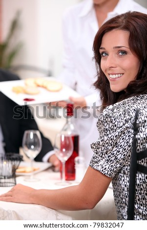 Smiling woman at a dinner - stock photo