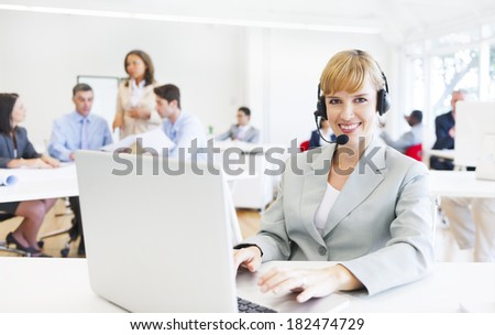 Smiling Woman at Call Center - stock photo