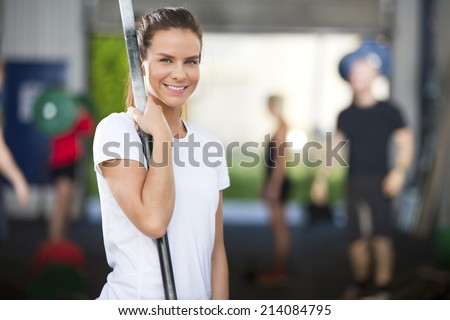 Smiling woman at fitness gym center - stock photo