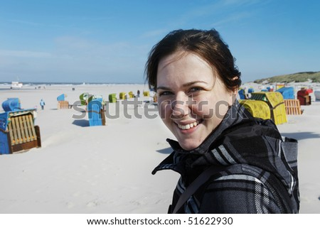 Smiling woman at the beach of the german island Juist - stock photo