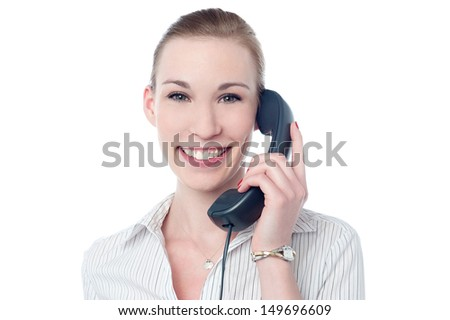 Smiling woman attending customer's call - stock photo
