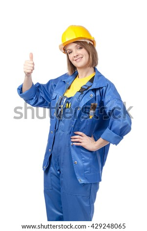 smiling woman builder in yellow helmet and blue workwear showing thumb up sign isolated on white background. proposing service. advertisement gesture