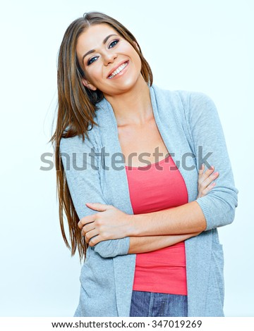 Smiling woman casual dressed standing against isolated background with crossed arms. Young model. Positive emotion. - stock photo