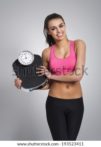 Smiling woman controlling her weight