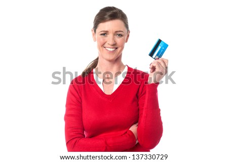 Smiling woman displaying her credit card, isolated over white.