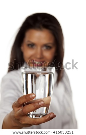 Smiling woman doctor holding a glass with water
