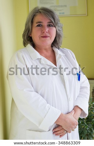 Smiling woman doctor portrait, in consulting room   - stock photo