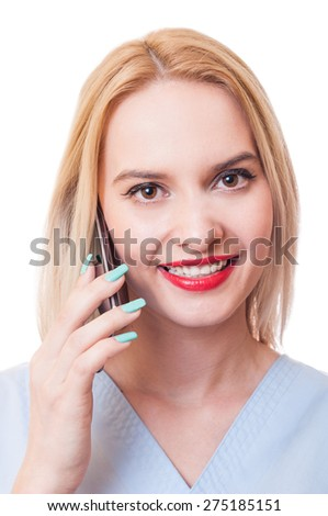 Smiling woman doctor talks on smartphone. Contactus concept on white background. - stock photo