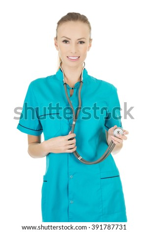 Smiling woman doctor with stethoscope. - stock photo