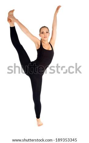 smiling woman doing pilates exercise, white background - stock photo