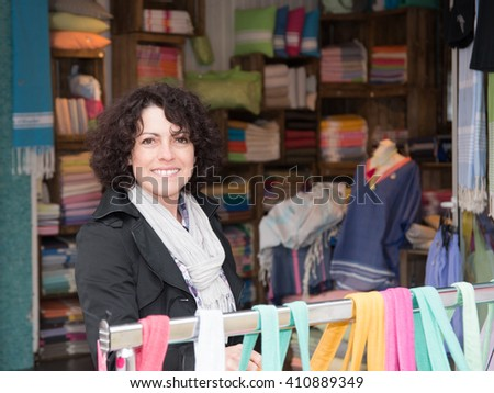 Smiling woman doing shopping in the city outside
