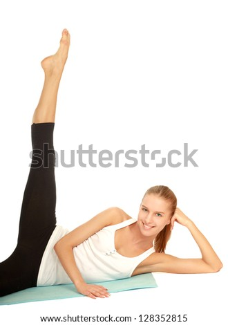 smiling woman doing stretching excersises isolated on white background - stock photo
