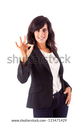 Smiling woman doing the OK sign - stock photo