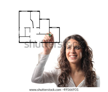 Smiling woman drawing the plan of a house - stock photo