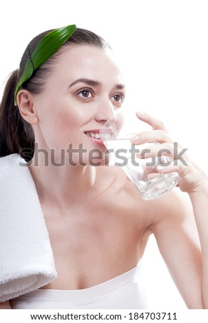 Smiling woman drink water from glass, isolated on white background.