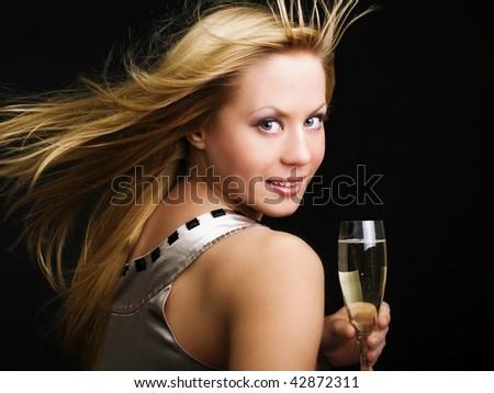 smiling woman drinking champange and celebrating - stock photo