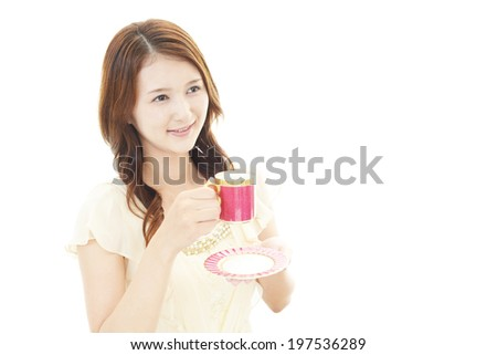Smiling woman drinking coffee. - stock photo