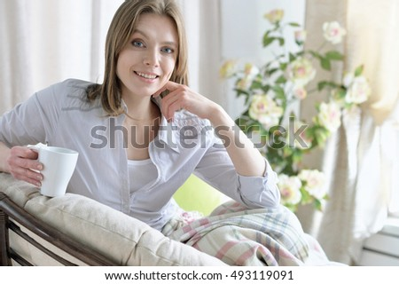 smiling  woman drinking tea