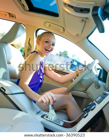 smiling woman driving car - stock photo