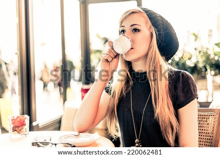 Smiling woman during coffee break - stock photo