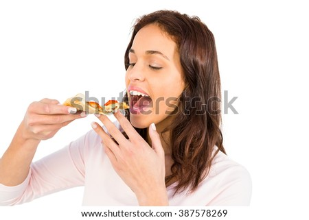 Smiling woman eating a slice of pizza on white background