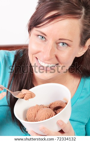 Smiling woman eating ice cream - stock photo