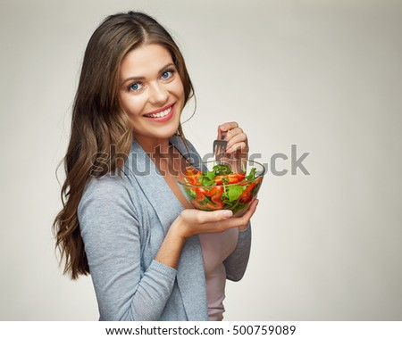 smiling woman eating salad. portrait of beautiful girl with healthy food, isolated.