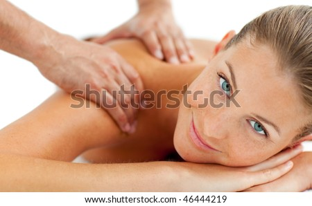Smiling woman enjoying a massage in a spa center - stock photo