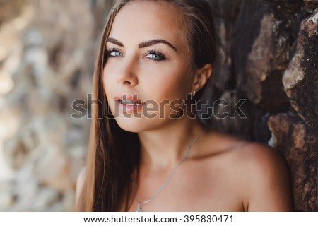 Smiling woman.Fashion portrait,beautiful woman,summer outdoors.Soft warm vintage color tone.Artsy bohemian style.amazing skin tone,cat eye,mascara,body care,cream mask,glowing radiant skin tone - stock photo