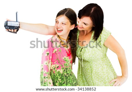 Smiling woman filming with home video camera isolated over white - stock photo