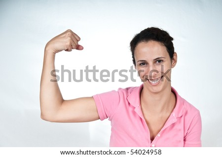 smiling woman, flexing her bicep muscle - stock photo