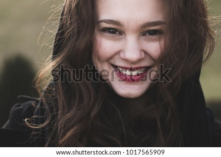 Smiling woman. Happy woman portrait. Toothy smile outdoors.
