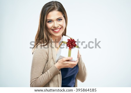 Smiling woman hold red gift box. Isolated white background. Studio. - stock photo