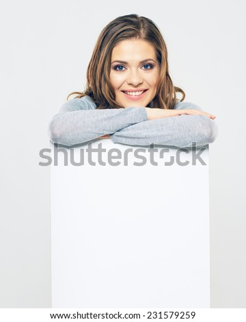 smiling woman hold white banner. isolated portrait. studio background. - stock photo