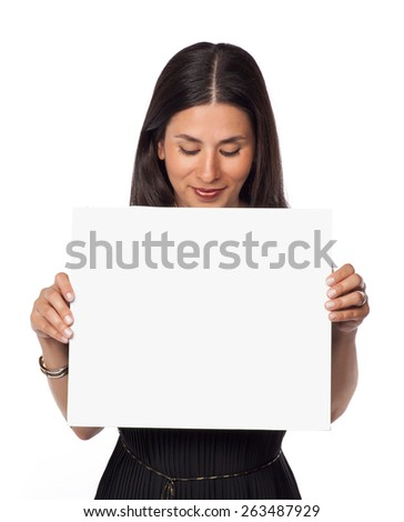 Smiling woman holding a blank board - stock photo