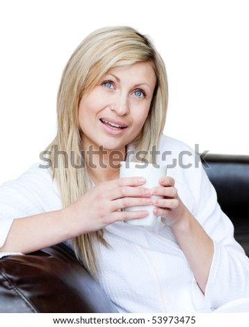 Smiling woman holding a cup of coffee against a white background