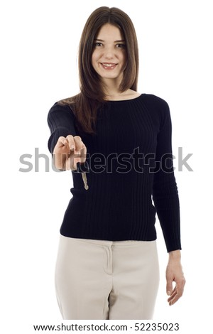 Smiling woman holding a key over white background - stock photo