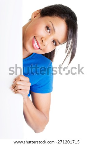 Smiling woman holding blank banner. - stock photo