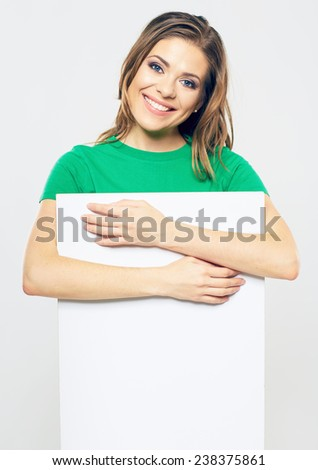 smiling woman holding blank business sign board. studio portrait of beautiful girl. isolated portrait. - stock photo