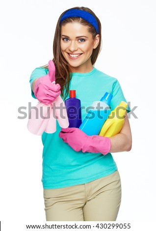 Smiling woman holding bottle of chemistry for cleaning house show thumb up. Isolated portrait.