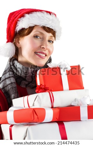 Smiling woman holding christmas presents on white background - stock photo