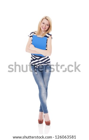 Smiling woman holding clipboard - stock photo