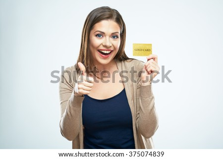 Smiling woman holding credit card show thumb up. Happy girl portrait. - stock photo