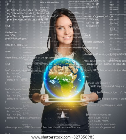 Smiling woman holding Earth globe over tablet on computer code background. Elements of this image are furnished by NASA - stock photo